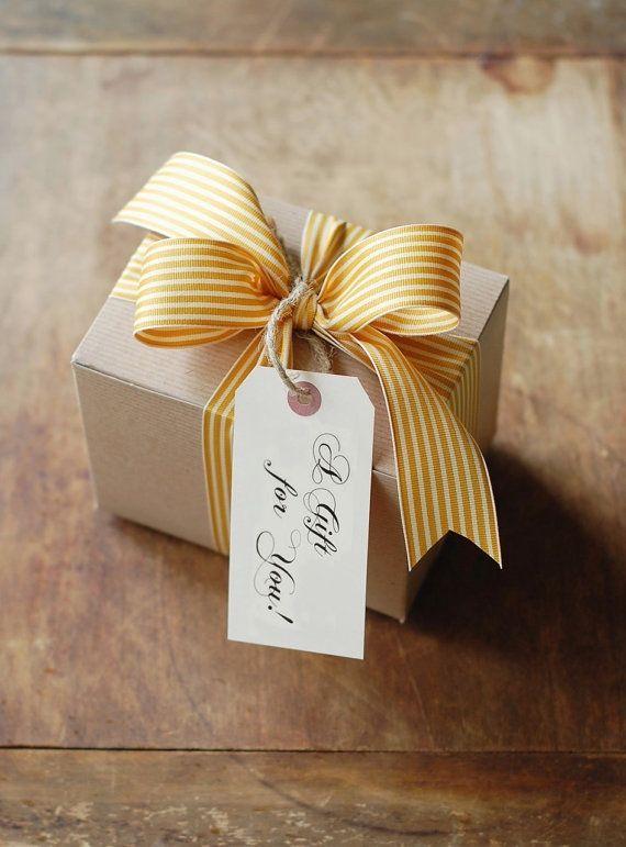 Brown box, striped ribbon in cornflower, simple tag.