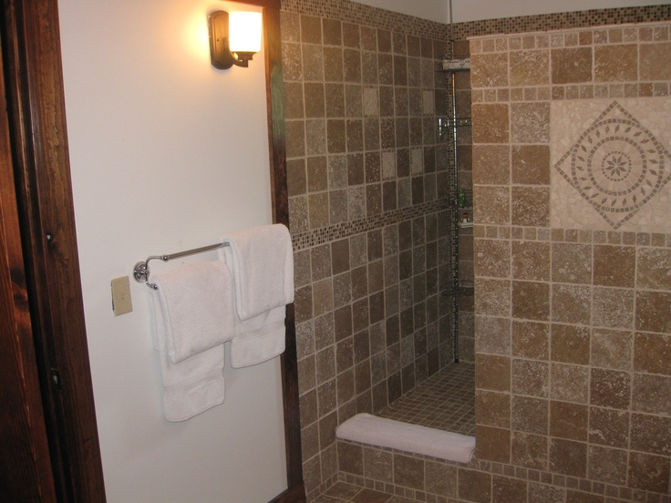 New For 2012 The Wood Violet Room A Large Walk In Shower Stall Of Travertine Stone Tile