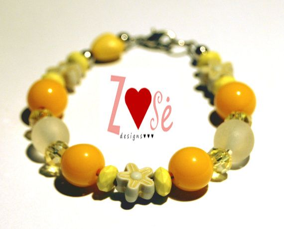 Girls yellow bracelet size large. Fits ages 58 by ZoseDesigns, $10.00