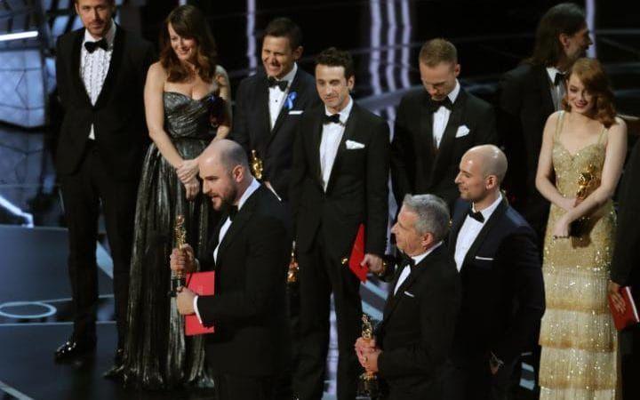 The La La Land team on stage before they were stripped of their award