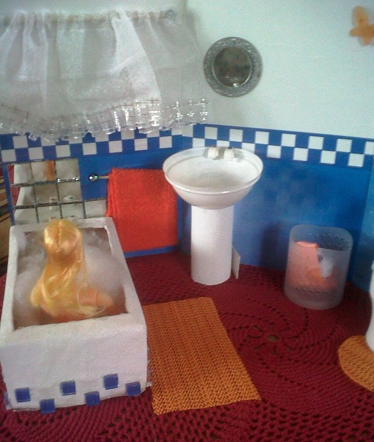 Barbie bath made out of tissue box mosaic tiles and rails made out toothpick and scrap material