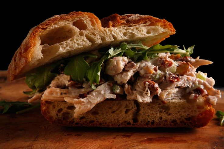 A chicken salad recipe with roasted chicken, crunchy almonds, cherries, thyme, and celery, served as a salad with lettuce or in a sandwich.