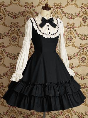 Lolita Fashion pretty black and white dress with white bib and black trim and bow.