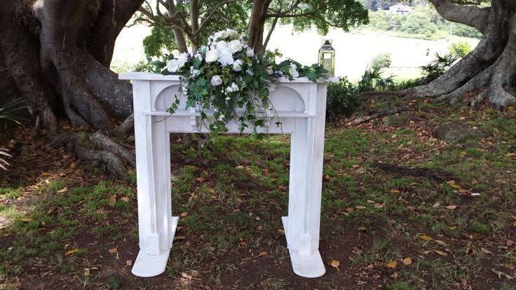 Beautiful mantle with cascade of fresh and silk flowers for an out door ceremony.