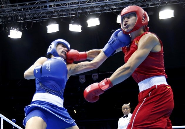 Sweden's Anna Laurell (R) fights against Australia's Naomi-Lee Fischer-Rasmussen during their Women's Middle (75kg) Round of 16 boxing match during the London 2012 Olympic Games August 5, 2012.