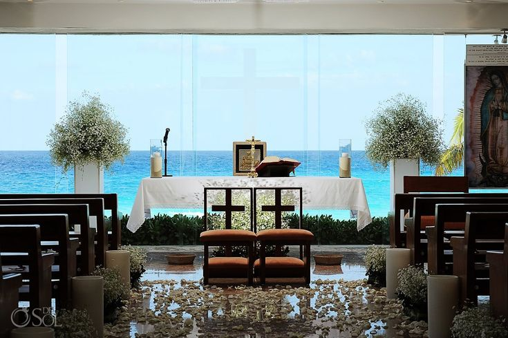 Cancun Wedding Venue – Our Lady of Guadalupe Chapel One of the most epic views of the caribbean ocean in Cancun Mexico, featuring a full glass wall between the guests watching the ceremony and an unbelievable paradise.