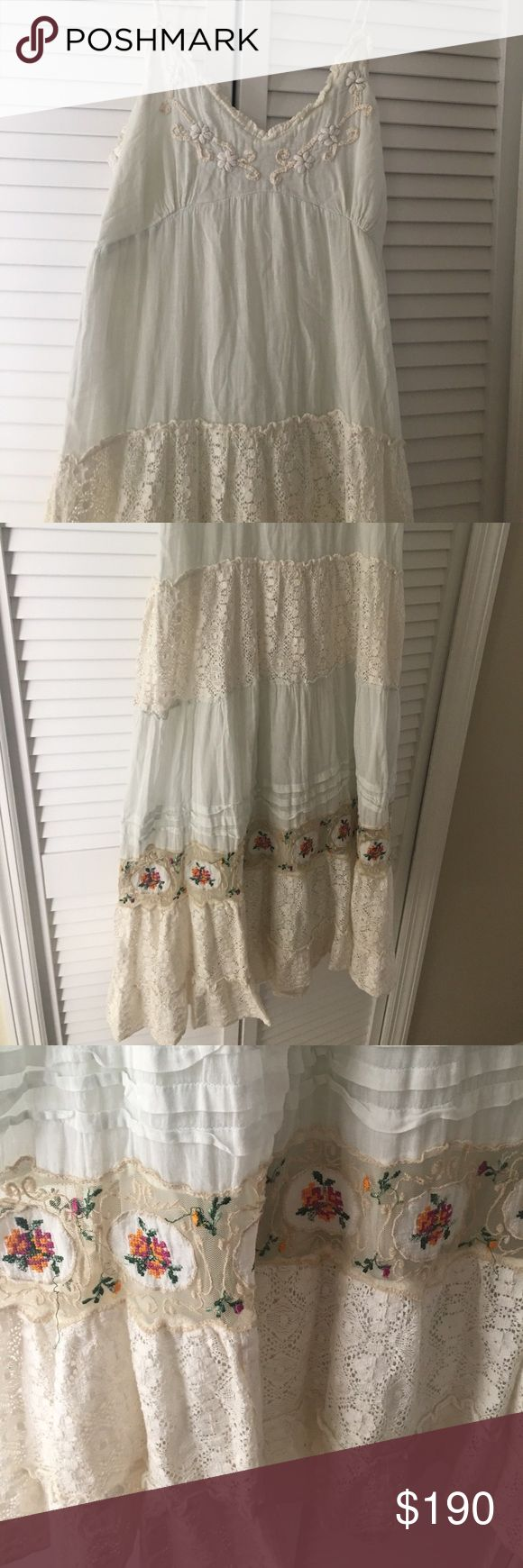 Amazing full length embroidered dress 👗 S-M-L Lovely watercolor mint green almost white , with cream color embroidery along neckline and cream lace inserts and also beige lace with pink orange green floral embroidery accents on beige lace on skirt part , see pics, enchanting style fits sizes SML since it has a stretchy back panel for perfect fit, and adjustable straps, fabric is cotton voile , very delicate beautiful dress 👗perfect for vacations beach special events , looks great with…