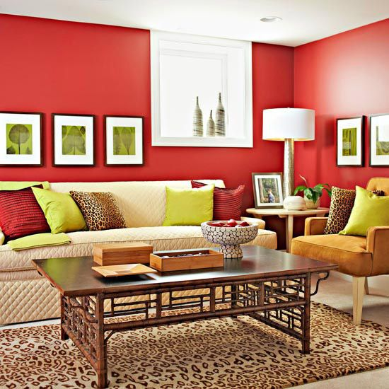 Saturated Color Scheme: Wine + Tan.   Wine-red walls warm up a basement family room to counteract the inherent coolness of an underground living space. Neutral furnishings, dotted with red pillows and accessories, offset the deep hue. To make low basement ceilings feel taller, keep them white, if possible, and hang a row of framed artwork relatively low.