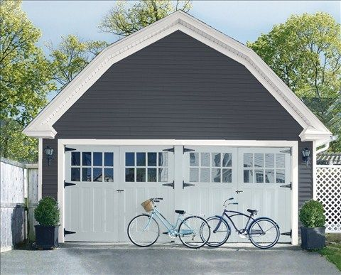 Look at the paint color combination I created with Benjamin Moore. Via @benjamin_moore. Siding: Baby Seal Black 2119-30; Trim: American White 2112-70; Garage Doors: Silver Gray 2131-60.