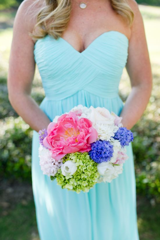 Bright bouquet and bridesmaids dress. --- http://www.weddingchicks.com/2014/06/09/moores-mill-club-wedding-by-the-studio-b-photography/