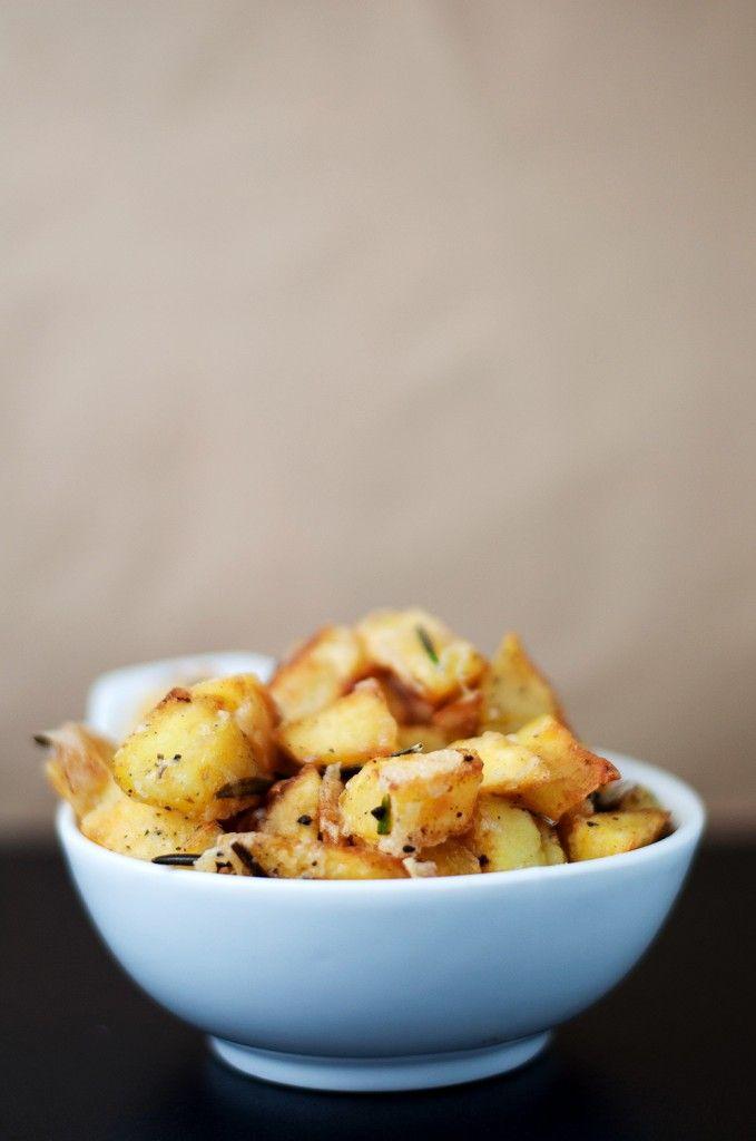 Rosemary Garlic Potatoes        2 Potatoes      Parmesan      Rosemary      2 Cloves of Garlic      Butter      2-3 Tbsp Canola Oil      Salt  Pepper