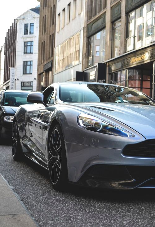 Aston Martin Vanquish. Does anyone else start singing the song from Ferris Bueller when he sees the 1961 Ferrari 250 GT California Spyder, when they see a car like this? Or is it just me?