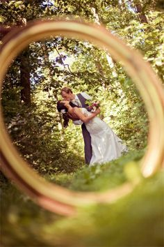 Must Have Wedding Photos - Bride and Groom Wedding Pictures | Wedding Planning, Ideas & Etiquette | Bridal Guide Magazine. Through your ring.