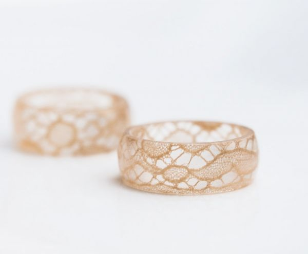 Vintage French lace is encased inside this translucent ring, made from eco-friendly resin.