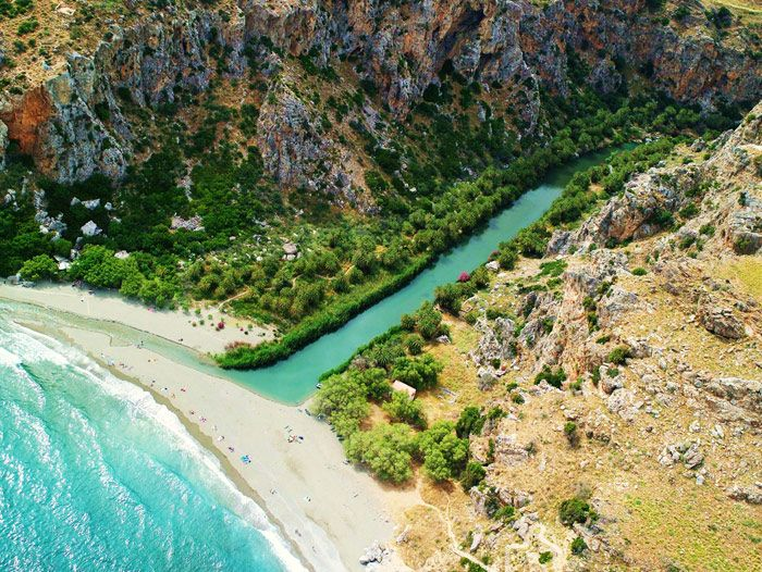 The wonderful beach of Preveli with a small river flowing into the sea!