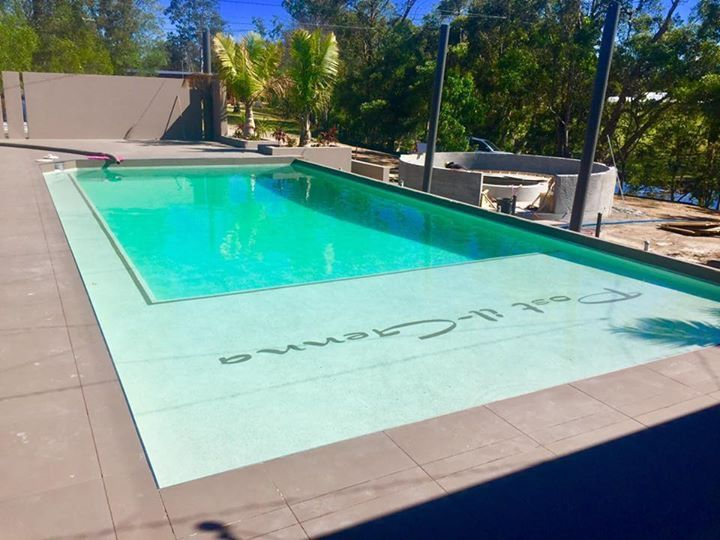 Inground concrete pool with pebbled interior and laser cut graphic
