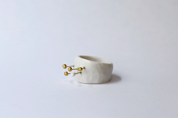 Guadalete, porcelain ring, glazed and painted with gold by Goutte de terre on Etsy.
