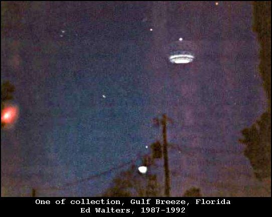 1987 - Gulf Breeze, Florida. Though many sighted the elusive flying craft and snapped photographs of the glowing lights, the majority of attention was on one Edward Walters, a local building contractor. According to Walters, the sightings began on November 11, 1987. He was working late that night when his attention was drawn to a light coming from his yard. As he went to the window to get a better vantage point, he saw a glowing object partially obscured by a 30 foot tall pine tree.