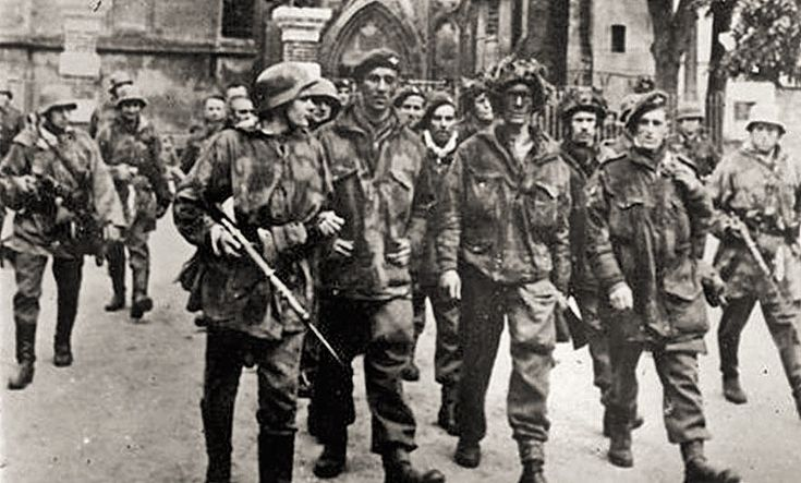 6th Airborne Paratroopers - prisoners - in Saint Pierre-sur-Dives 6 June 1944. Some escaped when Allies bombed the convoy of trucks taking them to an internment camp.
