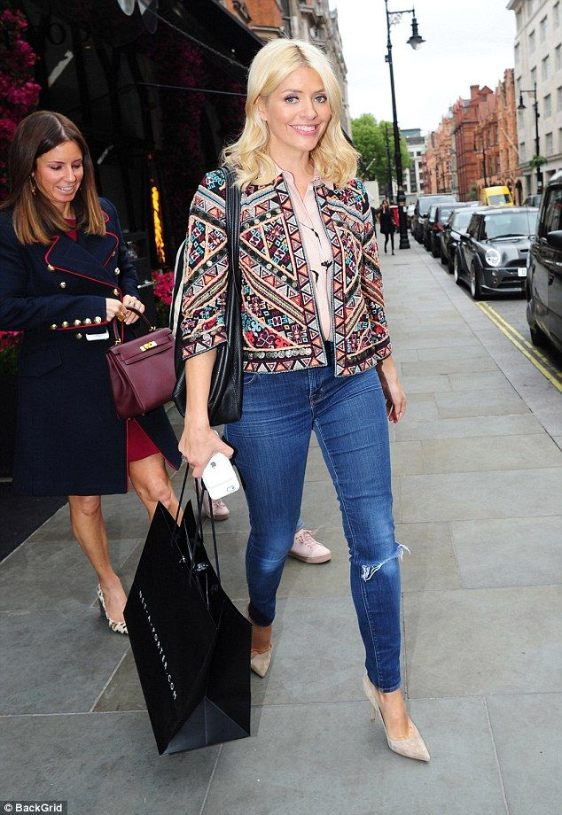 Cutting loose: Holly Willoughby, 36, looked incredibly in a funky jacket and skinny jeans as she enjoyed an evening out at Scott's restaurant in London on Thursday.