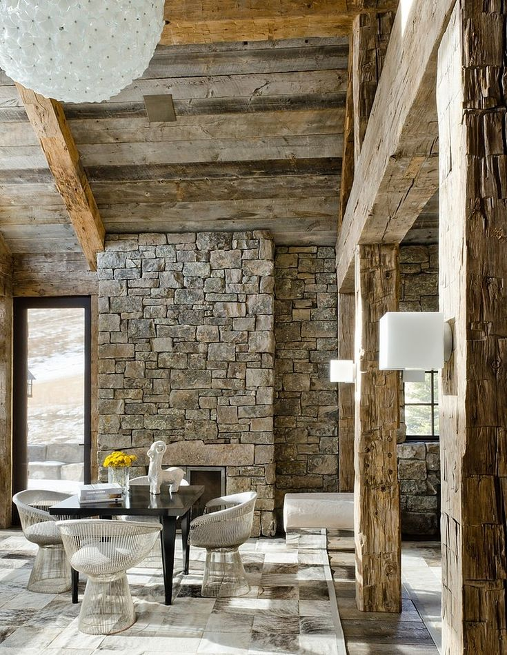 Warren Platner Lounge chairs for dining room, reclaimed, hand awl cut beams and ceiling boards, earth tones throughout Rustic Residence by On Site Management