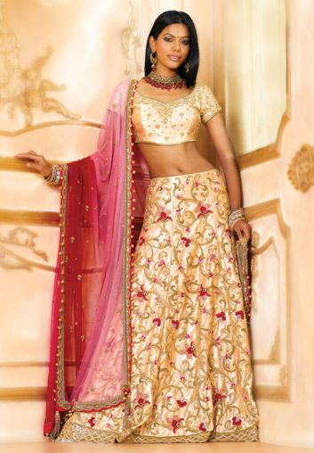 BW48 Light Gold & Pink Lehenga GHAGRA CHOLI Light gold satin skirt with resham and zardozi all over jaal embroidery with thick scallop bordered hem teamed with short choli and beautifully shaded maroon to pink net embroidered dupatta.