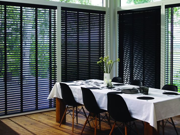 Modern and minimal is the only way to go for this large expanse of windows, but if your choice of window covering is a dark wooden venetian blind, then be sure to carry the colour through to other areas of the décor or it could become a little overwhelming. From £40. Online at http://www.polesandblinds.com/sherwood-red-alder-wooden-venetian-blind/ #diningroom #interiordesign #blinds