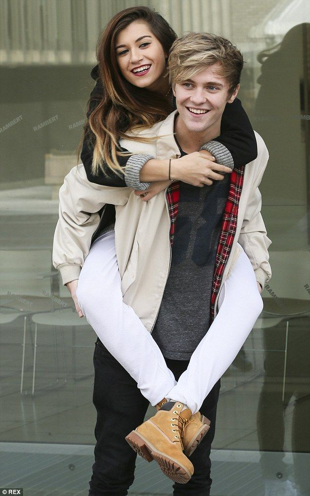 Got your back:Parisa Tarjomani gets a piggy back off her bandmate Mikey Bromley