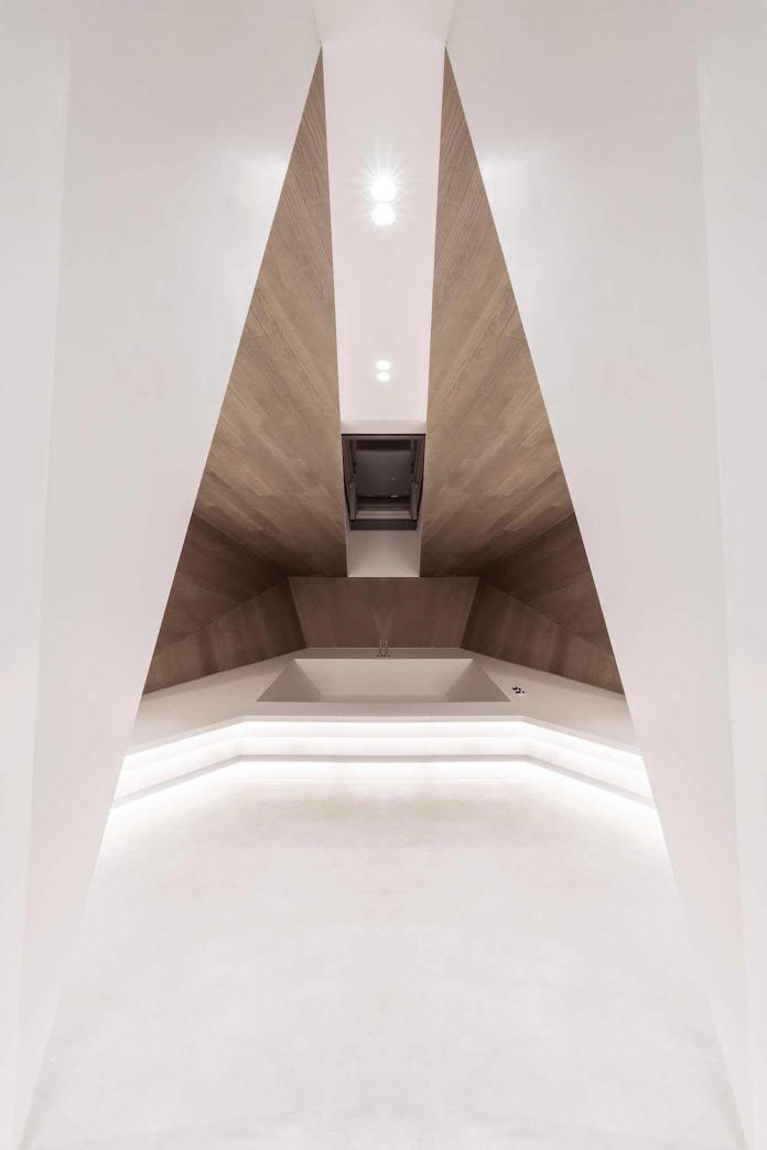 Rounded concrete staircase opens up all rooms and also appears to be carrying them - Page 2 of 2 - CAANdesign | Architecture and home design blog