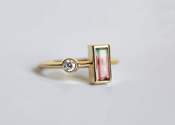 Hey, I found this really awesome Etsy listing at https://www.etsy.com/listing/234344930/baguette-diamond-ring-bi-color
