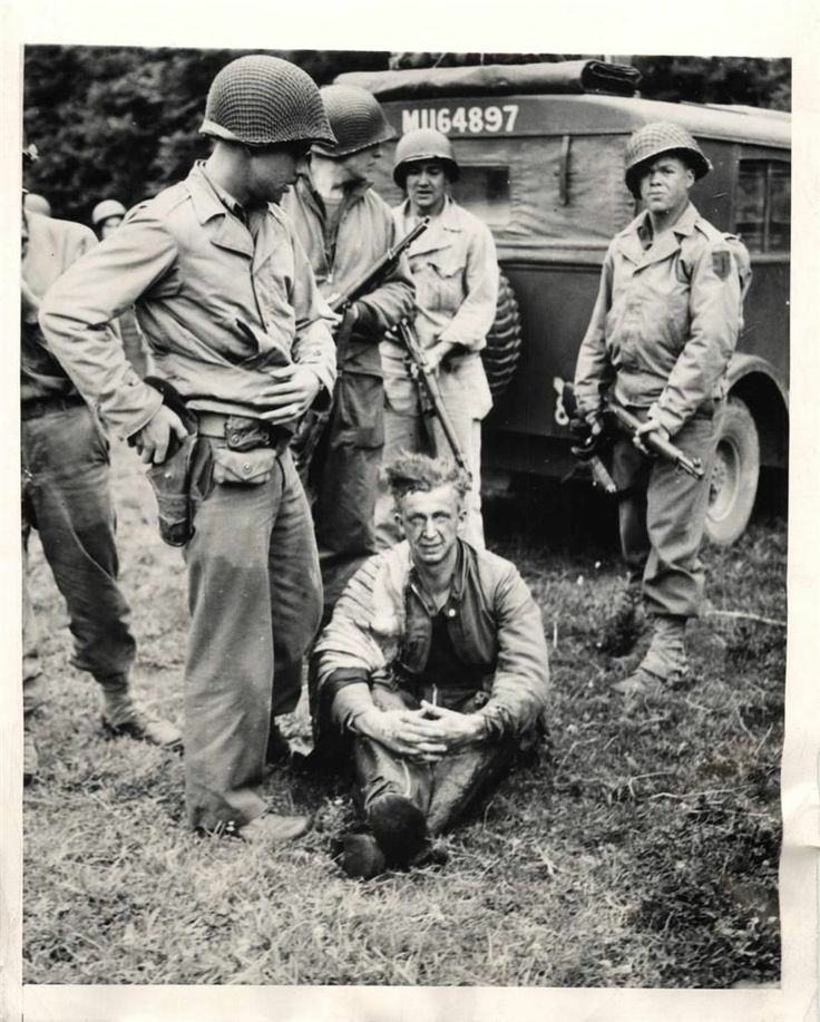 Wwii u s 1st division troops w captured german pilot in - French div 2 ...