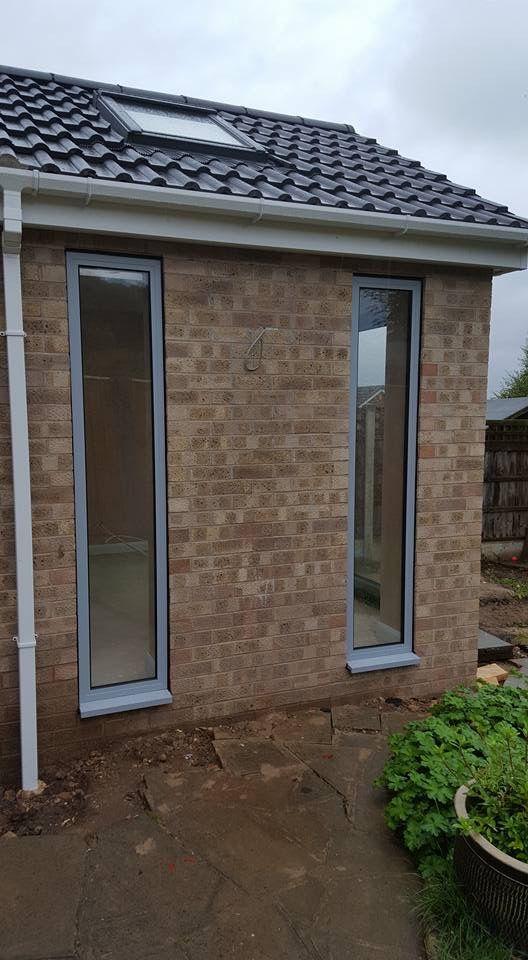 AluK GB Ltd Aluminium Windows And A Set Of Bi Folding Doors With Satin  Hardware,