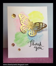 gold butterfly on watercolours