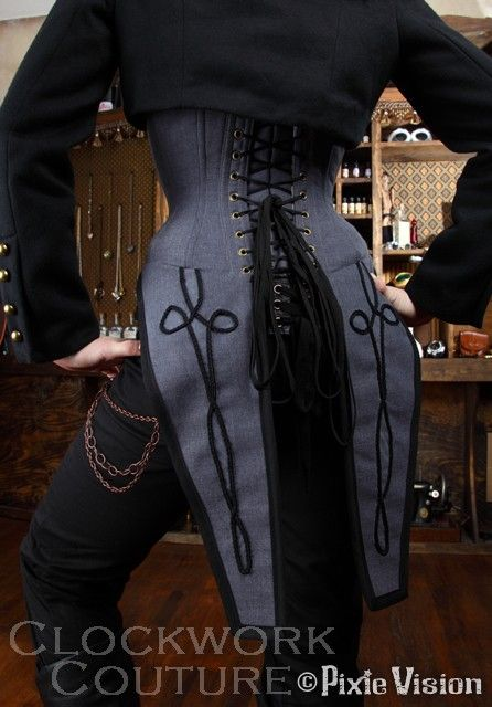 The awesomeness of this waistcoat is overwhelming.I want to see the front. Looks like a corsette to me.