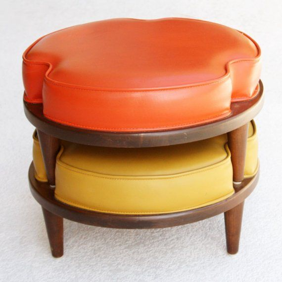 These are classic mid century ottomans that were made in the early 1960s. Ottomans such as these were constructed for use alone, or to stack