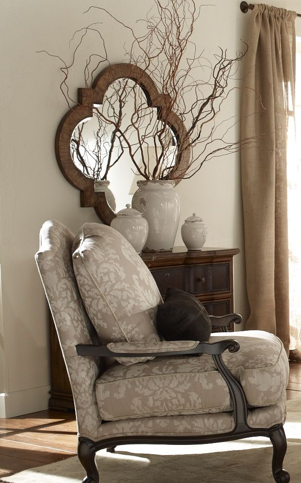 lovely Grey chair and walls with quatrefoil framed mirror.