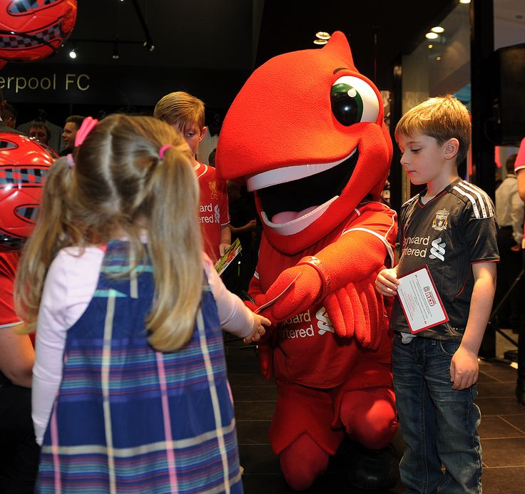 Might Red meets a couple of young Reds at the opening of the Official Liverpool FC Store Dublin