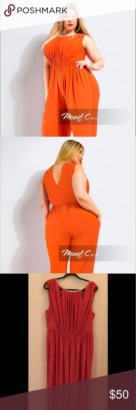 Monif C Camilla Tangerine Draped Jumpsuit Unleash your feminine side! Featuring chain mechanics detail, peek-a-boo neck cutouts, relaxed fit pant leg and gathering in all the right places.  Go all out and style it with a strappy sandal or wear with a blazer a sleek heels for the office.  Only has been worn once. Monif C. Pants Jumpsuits & Rompers