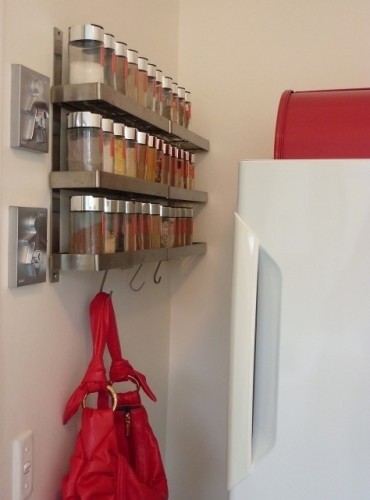I like this spice rack storage idea.