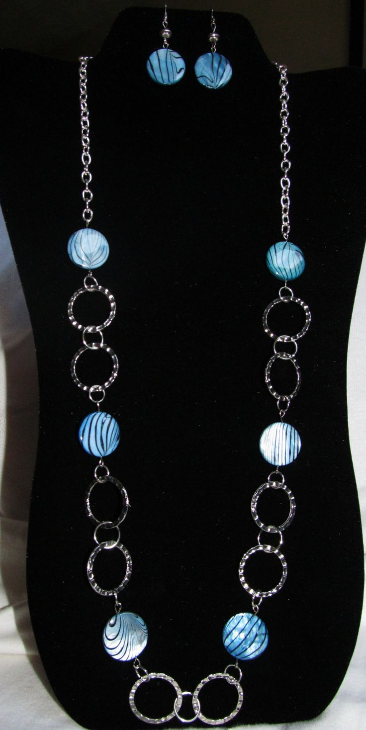 LOVE THIS! Blue and Black Shell Beaded Necklace on Silver Chain with Matching Earrings. $22.00, via Etsy. Katya Valera ~ handcrafted jewelry
