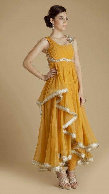 Saffron draped tulle anarkali with asymmetrical cascades down the side and back. Hand embroidered Swarovski Elements embellishment on shoulder, neckline and bustline by Gaurav Gupta $1,970