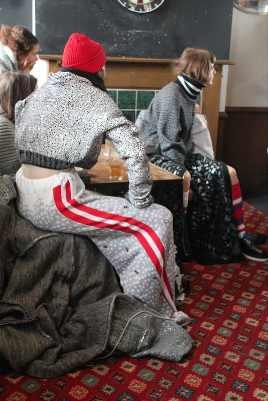 """Grace Lant knitwear. Wonderland, July 2016. """"My starting point was English football....if anyone has been to a football game in the north of England in the heart of winter it wouldn't be a stretch to describe it as freezing. I wanted to emulate everyone wrapping up to support their team: the oversized aspect also came from me wearing my dad's old football shirts and jackets."""""""