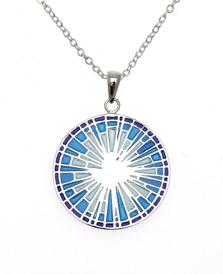 Medieval+Stained+Glass+Dove+Pendant+-+This+beautiful+necklace+is+designed+to+imitate+the+beauty+of+medieval+stained+glass+through+its+use+of+translucent+enamel.+Within+the+centre+of+the+circle,+made+in+lovely+shades+of+blue,+there+is+an+ornate+design+featuring+a+dove.+This+necklace+would+make+a+perfect+gift+as+it+comes+beautifully+packaged+in+a+purple+box.+