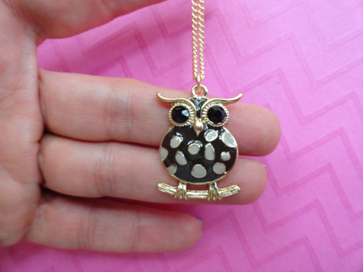 Owl grey and black polka dot enamel necklace. Cute owl on branch pendant necklace has enamel black body with grey polka dots and black crystal eyes for fun look . 1 inch Hangs on 20 inch gold plated chain