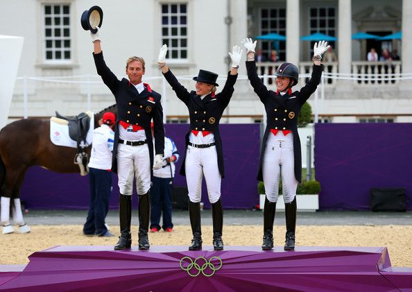 Charlotte Dujardin Photos Photos - (L-R) Carl Hester, Laura Bechtolsheimer and Charlotte Dujardin of Great Britain celebrate before receiving their gold medals during the medal cerermony for the Team Dressage on Day 11 of the London 2012 Olympic Games at Greenwich Park on August 7, 2012 in London, England. - Olympics Day 11 - Equestrian