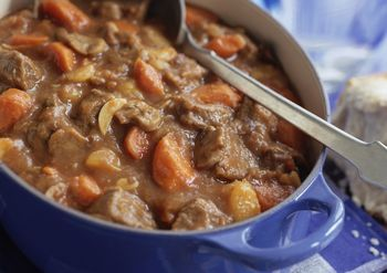 This hearty crockpot beef stew recipe has potatoes, carrots, onion soup mix, seasonings, and tomato paste and peas.