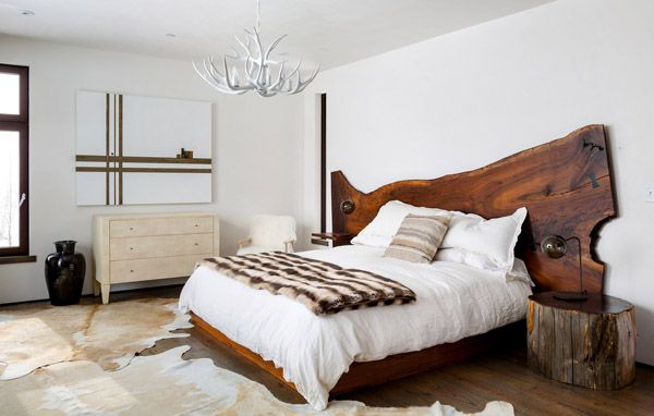 """Jackson Hole modern mountain retreat by Pearson Design Group. In the master bedroom is a custom-designed Claro walnut bed. Over the shagreen-covered Sorin Dresser from Made Goods hangs """"A Calf in Between,"""" by Craig Spankie. The antler chandelier is by Frank Long."""
