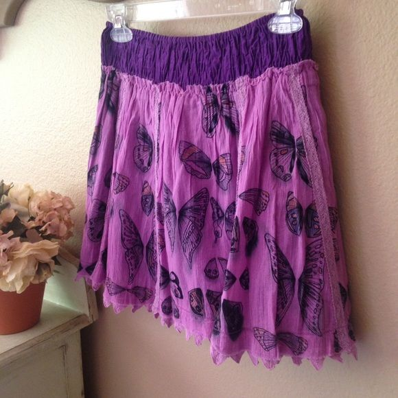 "FREE PEOPLE...Purple mini skirt. Butterflies everywhere! This adorable little mini skirt is loaded with personally. Purple and bright lavender, beautiful lace details, puckered waist band for an easy fit. Made with 100% cotton. Mint condition, never worn. Kept in my ""cedar"" lined closet. Reasonable offers are welcome. If you love FP check out my closet!! Free People Skirts Mini"