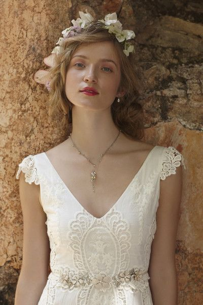 Dainty flutter sleeves, elaborate embroidery, and a tiered skirt set this #bohemian dress from @BHLDN