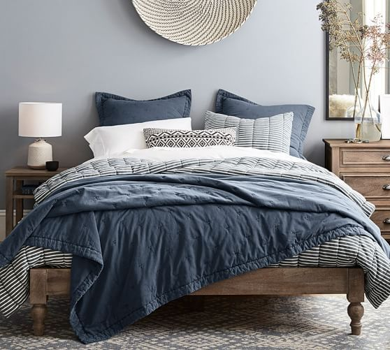 Ditch the headboard and box spring and pile up the pillows to make your own relaxing retreat. The Astoria Platform Bed has a low profile that feels comfy and casual, with a touch of romance in the turned legs. A light finish highlights the natural beauty of the mango wood's grain and hue, which vary slightly from piece to piece.